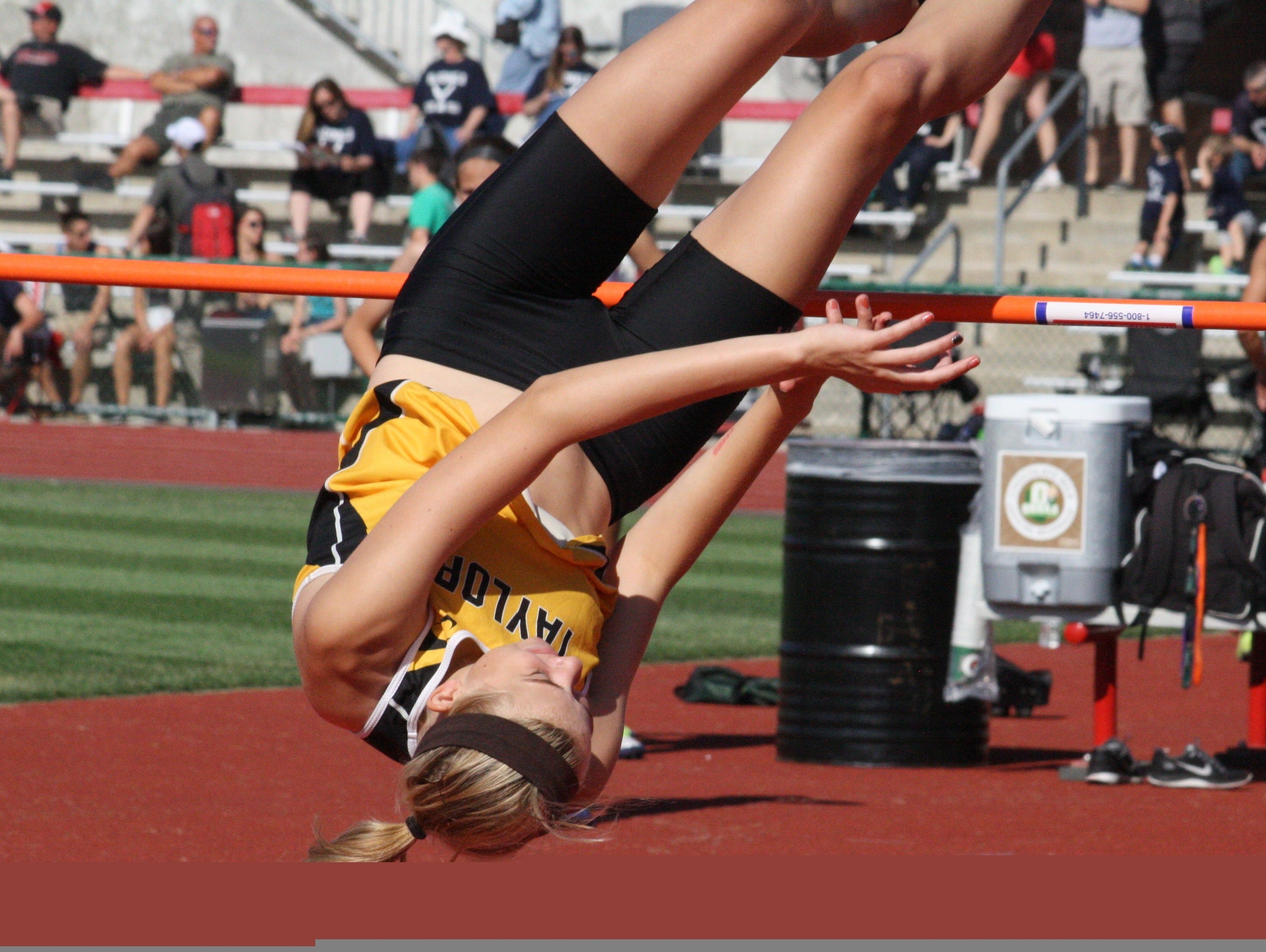 Taylor High School's Randi Schutte clears the bar in her opening high jump Division II state track and field championships June 6 last season at Jesse Owens Memorial Stadium.