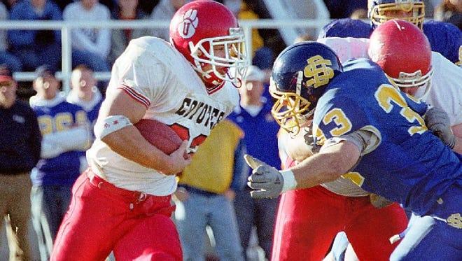 USD's Dusty Stamer gets past SDSU's Phil Oksness on Nov. 4, 2000 at Coughlin-Alumni Stadium.