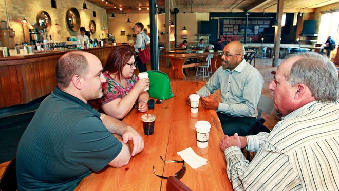 Mark Musa, left, is joined by co-workers Joelene Lowe, Perry Lewis (center right) and Mike Maiat  Anodyne Coffee, 224 W. Bruce St., for an afternoon coffee break.