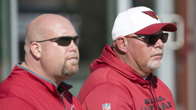 Cardinals general manager Steve Keim (left) and Cardinals head coach Bruce Arians look on during practice at the Cardinals training facility in Tempe on Wednesday, January 20, 2016.