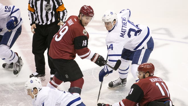 Scottsdale native Auston Matthews (34) of the Maple Leafs takes the opening face-off against the Coyotes' Shane Doan the NHL game at Gila River Arena in Glendale on Friday, December 23, 2016.