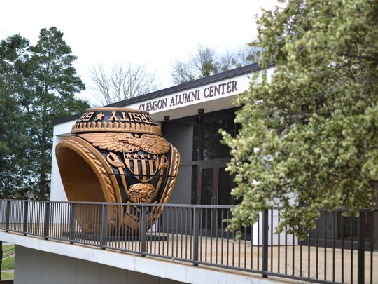 A class ring monument looms over the Clemson Alumni Center.