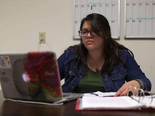 Kenya Sanchez, a DACA recipient, studies her chemistry homework inside the Multicultural Center at Angelo State University. Sanchez is one of about 800,000 DACA recipients affected by program's repeal.