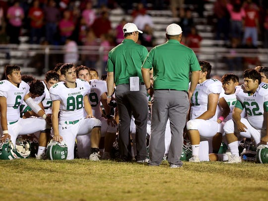 The Eldorado Eagles take a knee to listen to their