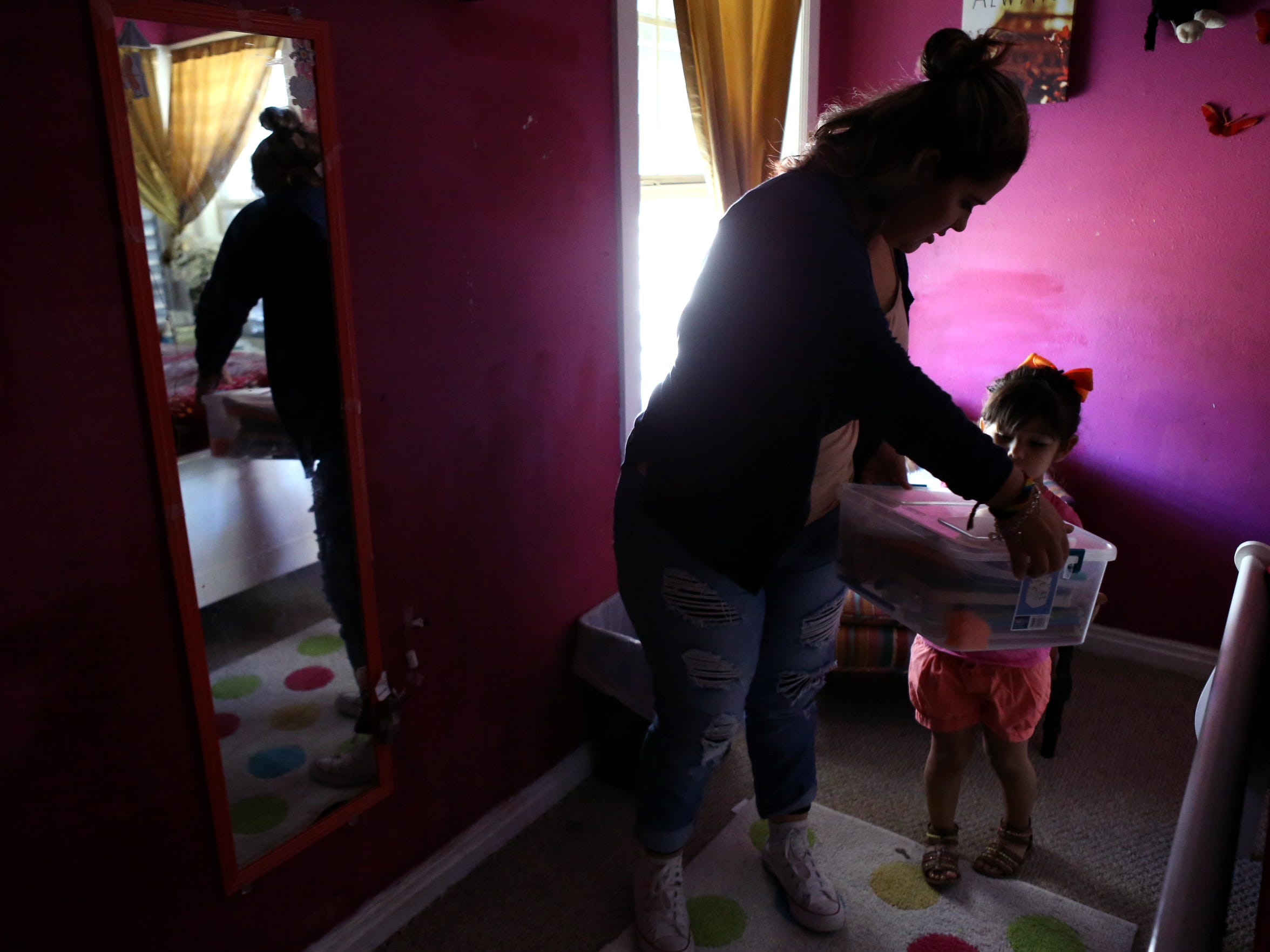 Claudia Jimenez gets markers for her niece Valeria Jimenez, 3, on October 16, 2017. ÒMy family, theyÕre my everything,Ó Jimenez said. ÒTheyÕre the only thing I have here.Ó
