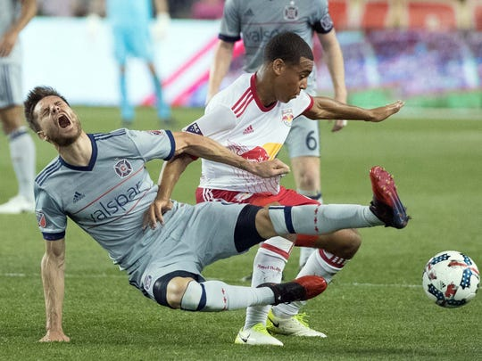 Chicago Fire forward Luis Solignac reacts after colliding