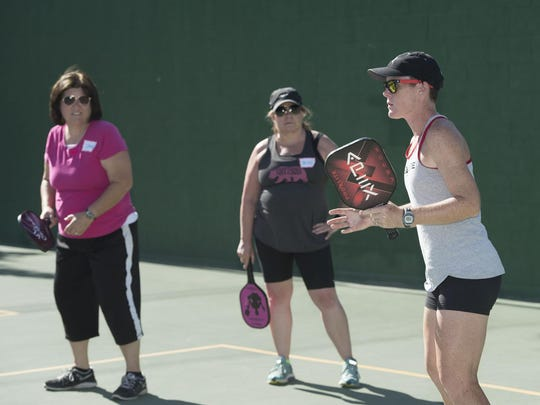 National Pickleball champion Sarah Ansboury, right, works with local players at Plaza Park in Visalia on Wednesday, June 15, 2016