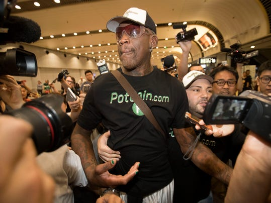 FILE - In this June 17, 2017, file photo, former NBA basketball player Dennis Rodman arrives at Beijing Capital International Airport in Beijing after a flight from Pyongyang. Rodman was sentenced to three years' probation after pleading guilty to two misdemeanors stemming from a January DUI arrest in Southern California. Rodman pleaded guilty Monday, March 12, 2018, in Orange County to one count of driving under the influence of alcohol and one count of driving with a blood-alcohol level above the legal limit of .08 percent. (AP Photo/Mark Schiefelbein, File)