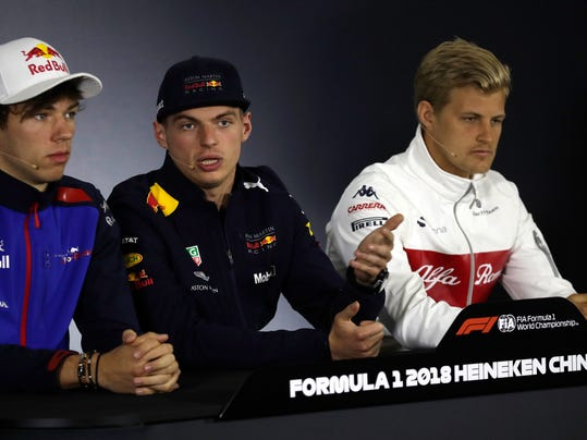 Red Bull driver Max Verstappen, center, of the Netherlands speaks next to Toro Rosso driver Pierre Gasly, left, of France and Sauber driver Marcus Ericsson of Sweden during a press conference at the Shanghai International Circuit ahead of the Chinese Formula One Grand Prix in Shanghai, Thursday, April 12, 2018. (AP Photo/Andy Wong)