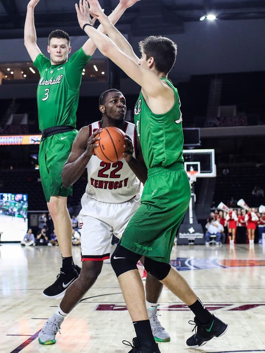Western Kentucky forward Dwight Coleby (22) looks to shoot while guarded by Marshall forwards Jannson Williams (3) and Ajdin Penava (11) during an NCAA college basketball game for the Conference USA men's tournament title Saturday, March 10, 2018, in Frisco, Texas. (Austin Anthony/Daily News via AP)