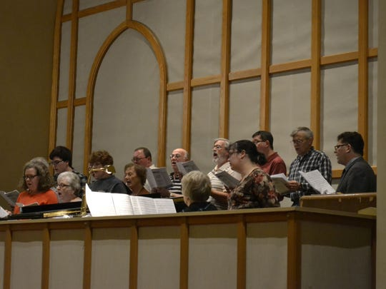 A choir with members from host church St. Mary of the Angels Parish and participants from other local churches sing Tuesday during the annual interfaith Thanksgiving worship service in Green Bay.