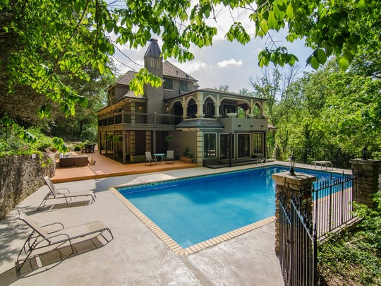 The home has a pool and multiple decks and patios to enjoy the scenery.