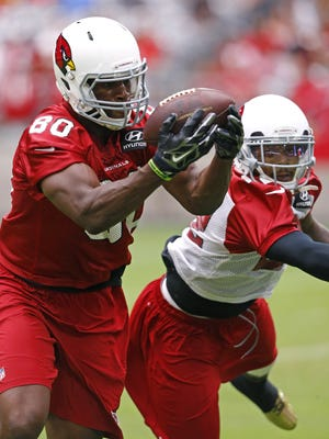 Arizona Cardinals tight end Ifeanyi Momah (80) eyes  the ball as he  makes a catch over the middle during training camp Sunday, August 2, 2015 in Glendale, Ariz.
