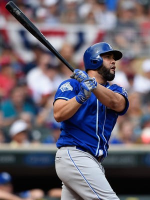 Kendrys Morales of the Kansas City Royals hits a three-run home run against the Minnesota Twins on Monday.