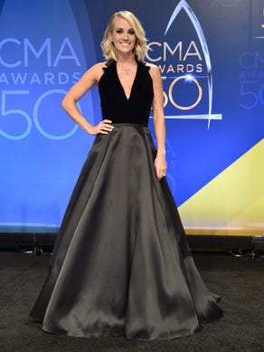 Carrie Underwood poses in the press room after winning