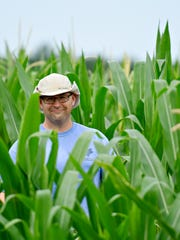 Hugh McPherson, of Maple Lawn Farms Farm Market & Orchards, shown in the corn maze in Fawn Township, Friday, July 21, 2017. Dawn J. Sagert photo
