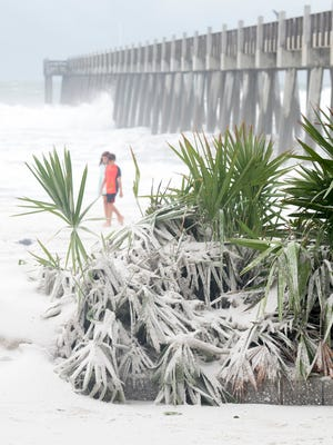 Drifted sand looks more like snow at the Casino Beach Bar and Grill after Hurricane Nate in Pensacola on Sunday, October 8, 2017.