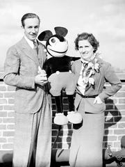 Walt Disney with his wife Lillian and Mickey Mouse, in 1935.