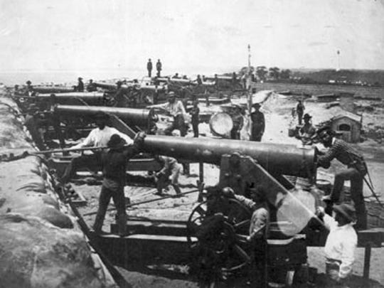 These heavy artillery guns near Pensacola were staffed by southern troops and were aimed at Union-held Fort Pickens cross Pensacola Bay in 1861. It is one of a significant group of photographs of southern soldiers in Florida made in 1861 by photographer J. D. Edwards of New Orleans.