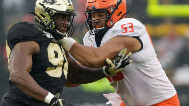 llinois offensive lineman Kendrick Green (53) blocks Purdue defensive end Kai Higgins (98) during ta game last season at Ross-Ade Stadium in West Lafayette, Ind.