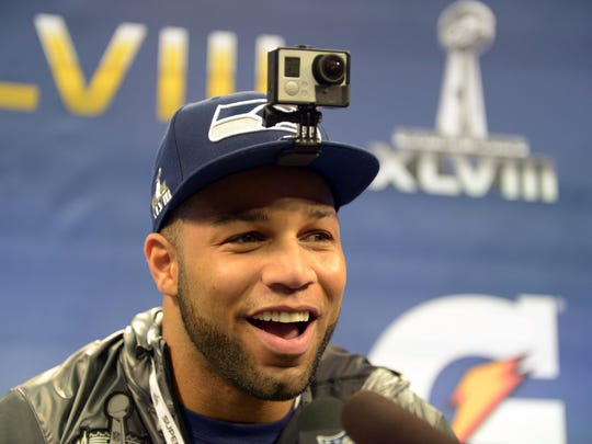 Jan 28, 2014; Newark, NJ, USA; Seattle Seahawks wide receiver Golden Tate is interviewed during Media Day for Super Bowl XLIII at Prudential Center. Mandatory Credit: Kirby Lee-USA TODAY Sports ORG XMIT: USATSI-175052 ORIG FILE ID:  20140128_pjc_al2_131.JPG