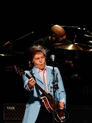 Paul McCartney rocks his bass while Abe Laboriel Jr. rails away on the drums. 