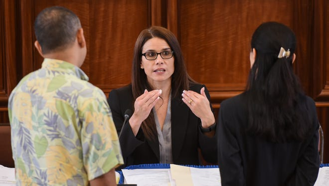 Department of Administration Director Christine Baleto, center, chats with Sen. Dennis Rodriguez Jr., left, and Vice Speaker Therese Terlaje during a committee of the whole session at the Guam Congress Building in Hagåtña on Tuesday, May 9, 2017.