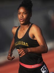 Kyla Robinson-Hubbard of Calabasas wins the girls 400-meter