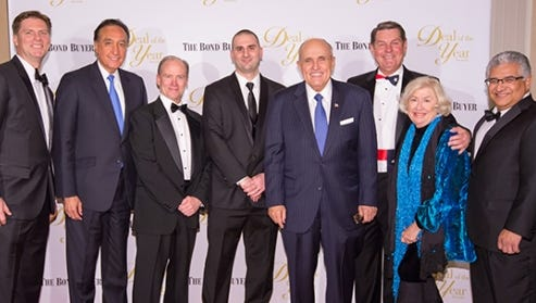 Left to right: Gerald Chicon, El Paso Housing Authority CEO; Henry Cisneros, former U.S. HUD secretary; Michael Ballinger, publisher of The Bond Buyer; Michael Scarchilli, The Bond Buyer editor-in-chief; Rudy Giuliani, former New York City mayor; Burt Blacksher, El Paso Housing Authority board chairman; and lawyers Jane Macon and William Avila, of the Bracewell & Giuliani law firm, which represented the El Paso agency in a $125 million bond transaction
