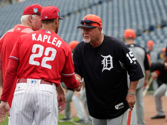 Philadelphia Phillies manager Gabe Kapler (22) shakes hands with Detroit Tigers manager Ron Gardenhire (15) before a baseball spring exhibition game, Tuesday, Feb. 27, 2018, in Clearwater, Fla. (AP Photo/Lynne Sladky)