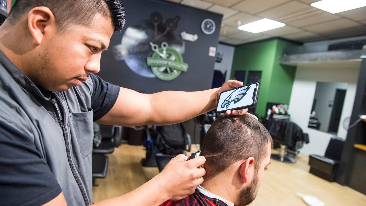 "Fidel Ramirez, a barber at Diversified Cuts in Hanover, buzzed the logo of the Philadelphia Eagles into the hair of ""die-hard Eagles fan"" Jose Beltran ahead of Super Bowl LII."