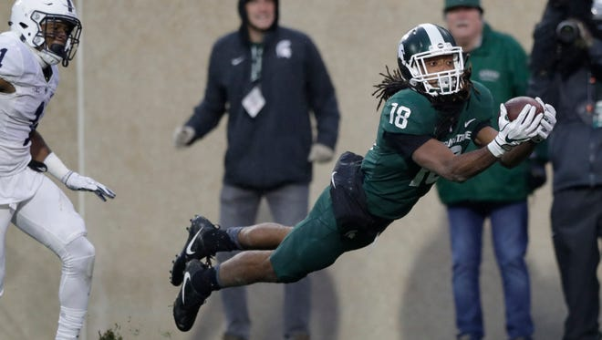 Michigan State wide receiver Felton Davis III (18),catches a touchdown in the first half of MSU's 27-24 upset of Penn State on Saturday.