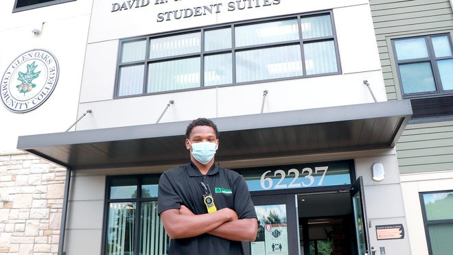 Tyquez Priester, a resident assistant at Glen Oaks Community College Devier student housing complex, pauses for a photo in between assisting incoming students.