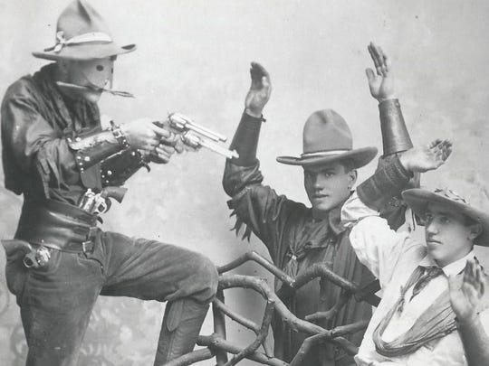 A scene from the Buffalo Bill Wild West Show. Freckles Atkinson is in the center with his hands raised.