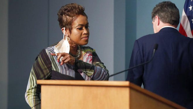 Machelle Sanders, Secretary of the North Carolina Department of Administration, comes to the podium to speak after being introduced by Gov. Roy Cooper during a briefing at the Emergency Operations Center in Raleigh, N.C., Thursday, June 4, 2020.
