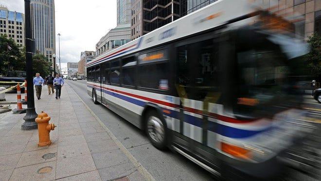 A COTA bus travels through Downtown Columbus.