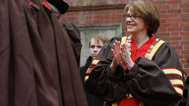 "Brown President Christina H. Paxson, shown at commencement in 2013, says the university's $10-million endowment ""will ensure sustainable financial support from Brown, enable continuous improvement to teaching and learning in Providence, and play an important part in promoting academic excellence and student success for generations to come."""