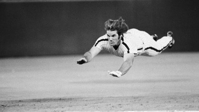 FILE - In this June 3, 1981 file photo, Philadelphia Phillies' Pete Rose dives headfirst for third base during a baseball game against the New York Mets in Philadelphia. Even Rose, the man who made the headfirst slide fashionable, says there's a time and place to be prudent. As in, no need to get your nose bashed in at home plate.