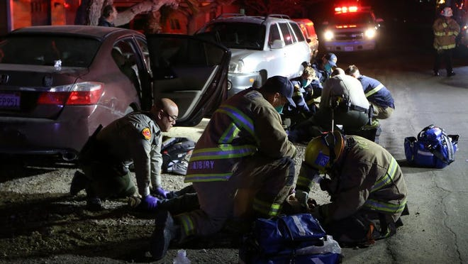 Kern County Sheriff's deputy assists firefighters in treating two men injured in crash in South Taft last week