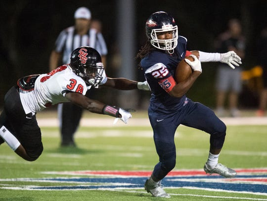 South-Doyle's Nate Adbeyo gets past Central's Marcus
