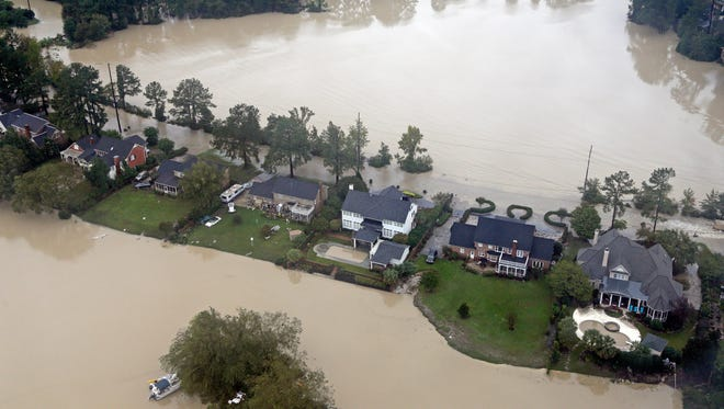 Floodwaters close in on homes on a small piece of land on Lake Katherine in Columbia, S.C., on Oct. 5, 2015.