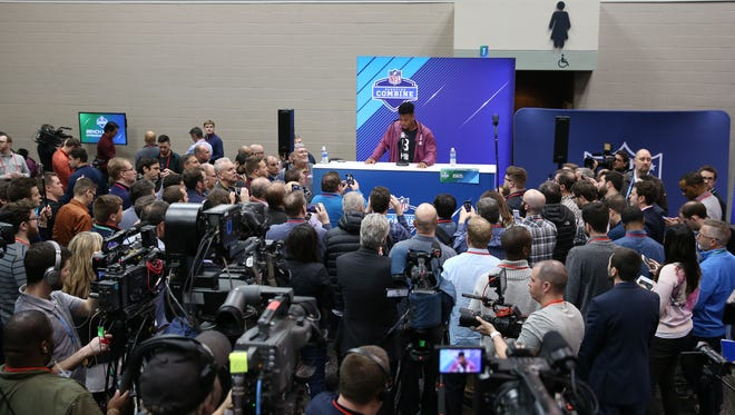 Penn State Nittany Lions running back Saquon Barkley (at podium) speaks to the media during the 2018 NFL Combine at the Indianapolis Convention Center.