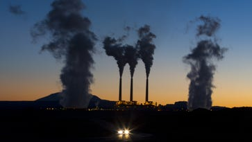 Evaporated water leaves the tops of stacks at the Navajo Generating Station near Page.