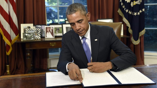 President Obama vetoes the National Defense Authorization Act Thursday in the Oval Office of the White House. The president vetoed the sweeping $612 billion defense policy bill, citing objections over how the measure is funded.