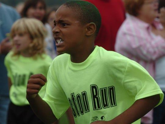 Seton Elementary School student Desmond Bane runs to