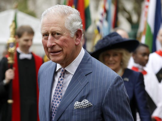 FILE - In this Monday, March 9, 2020 file photo, Britain's Prince Charles and Camilla the Duchess of Cornwall, in the background, leave after attending the annual Commonwealth Day service at Westminster Abbey in London, Monday, March 9, 2020. Prince Charles, the heir to the British throne, has tested positive for the new coronavirus. The prince's Clarence House office reported on Wednesday, March 25, 2020 that the 71-year-old is showing mild symptoms of COVID-19 and is self-isolating at a royal estate in Scotland. For most people, the coronavirus causes mild or moderate symptoms, such as fever and cough that clear up in two to three weeks (AP Photo/Kirsty Wigglesworth, File)