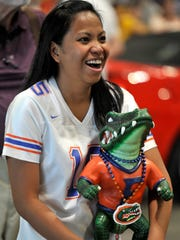 Mary Grace Wright waits to get an autograph from Tim Tebow atMusic City Sports Festival on Saturday.