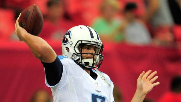 Titans quarterback Zach Mettenberger (7) throws a pass before the game against the Falcons at the Georgia Dome Saturday Aug. 23, 2014, in Atlanta, Ga.