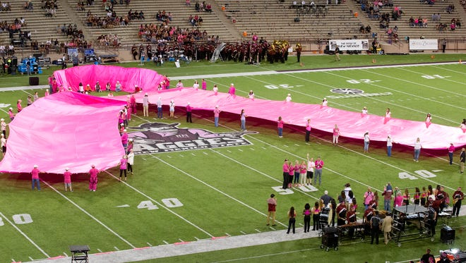 A 100-yard long pink ribbon in unveiled at half time of the NMSU vs. Georgia Southern football game. The Tough Enough To Wear Pink game is the premier event in the nation for raising funds for cancer research. 10/22-16