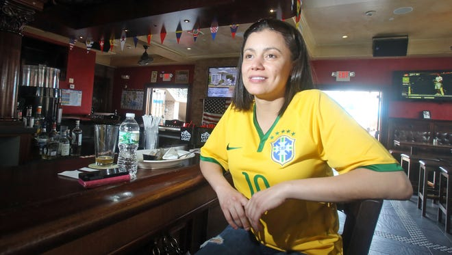 Isabel Freitas, wearing a Brazilian soccer jersey, has lunch in Molly Spillane's in Mamaroneck June 23, 2014. Freitas, who was born in Brazil and lives in Mamaroneck, was planning on spending the evening in the bar watching Brazil play it's World Cup Soccer match against Cameroon.